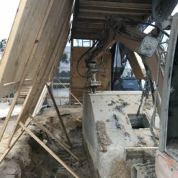 Hydrodemolition operation at 60 gallons per a minute at 20,000 PSI with a track hoe for removal of debris.