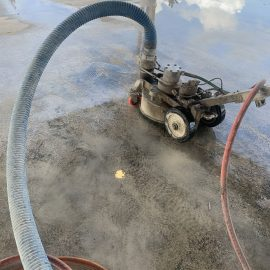 Deck machine with vacuum recovery performing surface preparation.